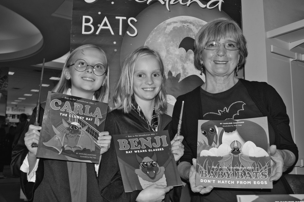 "Potterheads Neela and Brynn, 11, stopped to chat with Peachland's ""bat lady,"" Darlene Hartford, who was invited to attend the Harry Potter release party at Chapters in Kelowna July 30. Photo by Craig Gilbert"
